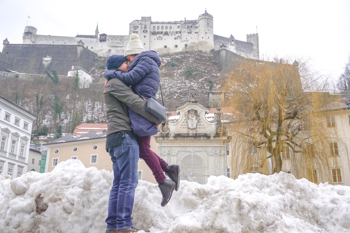Salzburg Snow Austria - Buy My Morning - Outside posing for a photo with Hohensalzburg Fortress behind us