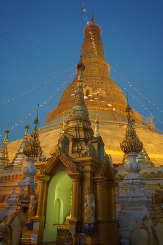 A photo up close to the incredible Shwedagon Pagoda with its huge point reaching into the sky | Buy My Morning