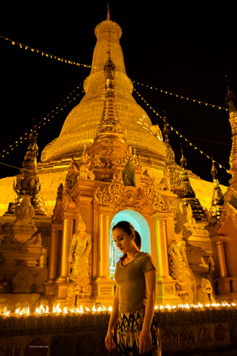Fani walking around the Shwedagon Pagoda with flames in the backdrop | Buy My Morning