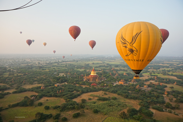 Flying in the air in a hot air balloon over Bagan, at sunrise | Buy My Morning
