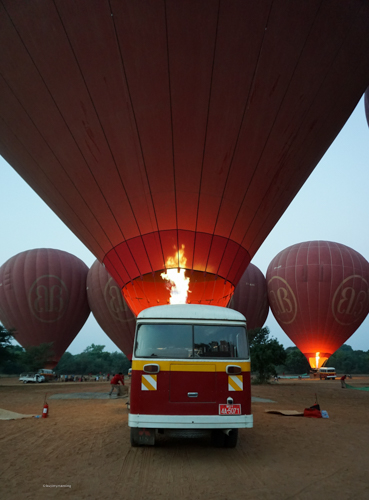The balloon bus and the team making the prep work for the hot air balloon flight in Bagan, at sunrise | Buy My Morning