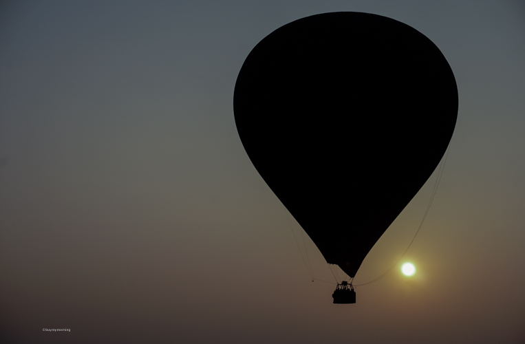 Hot air balloon flying in the sky in Bagan at sunrise | Buy My Morning