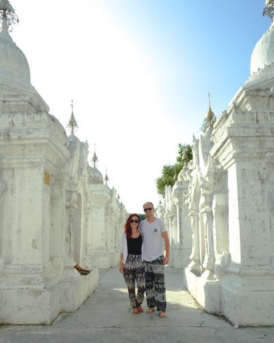 It's Dan & Fani standing along the pure white walkway, with some small dogging legs in view | Buy My Morning