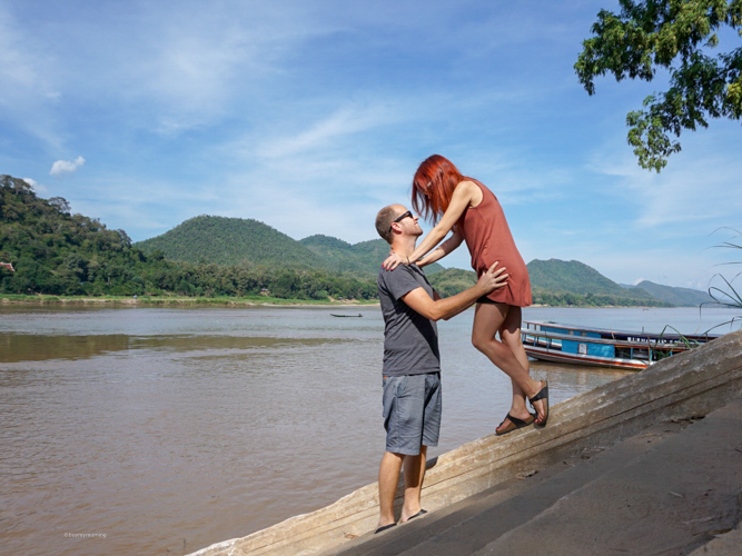 Dan and Fani standing (posing) on the last steps on the edge of the Mekong River in Luang Prabang, Laos | Buy My Morning