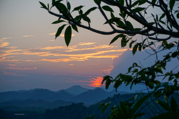 Beautiful sunset view from Mount Phousi, in Luang Prabang Laos. A View from heaven, looking out towards the mountains with a glow across the evening sky | Buy My Morning