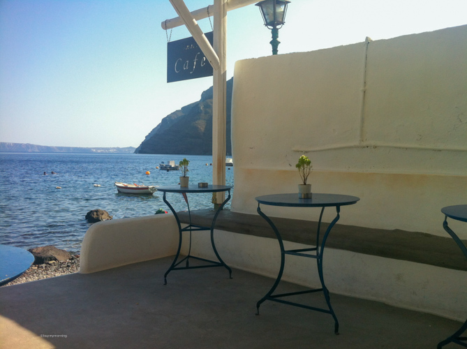 A tiny cafe on Thirasia island looking out to Santorini's main island | Buy My Morning