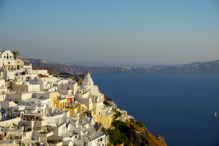 Stunning beauty of Thira Santorini, with complex building shapes along the cliff that touches nature and the sea | Buy My Morning
