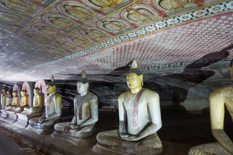 Dan & Fani inside the beautiful buddha caves with the stunning art work and patterns on display | Buy My Morning | Sri Lanka 8 day adventure itinerary