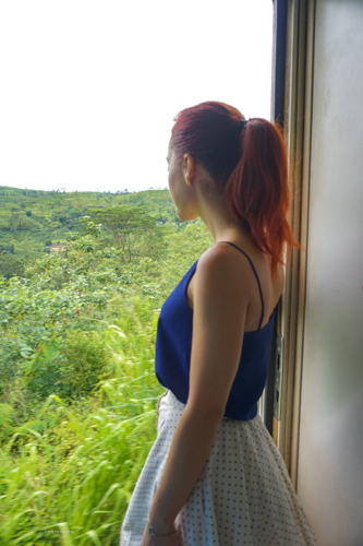 Fani looking out of the door on board world renowned scenic railway, on our way to Elle Sri Lanka | Buy My Morning | Sri Lanka 8 day adventure itinerary