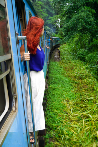 Fani posing from the open door on the world renowned scenic railway, on our way to Elle Sri Lanka | Buy My Morning | Sri Lanka 8 day adventure itinerary
